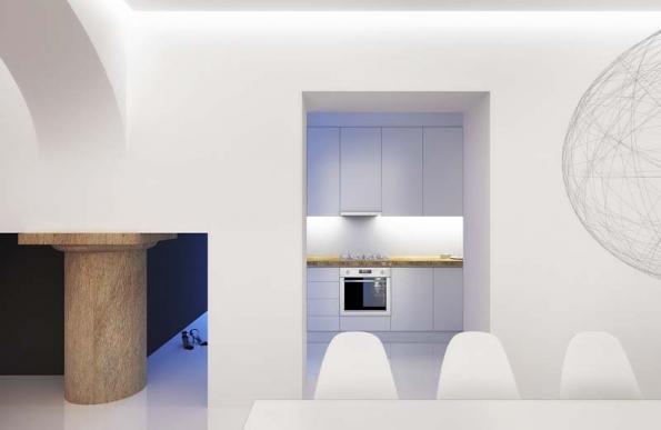 Kuchyňská linka plně využívá prostor niky vpředsíni, která je volně průchozí do obývacího prostoru.