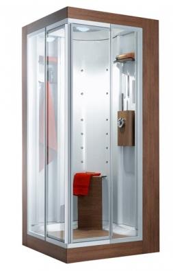 Sprchová kabina Colorem má ve výbavě 8 sekvenčních bočních trysek, 4 rozprašovací obličejové trysky, parní lázeň, hlavovou dvoufunkční sprchu s tropickým deštěm, ruční sprchu, osvětlení, termostatickou baterii, cena (bez DPH) za rozměr 100 x 100 cm a 120 x 80 cm v dekoru dřeva 162 336 Kč, IDEAL STANDARD.