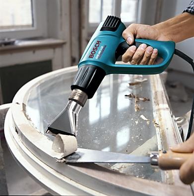 Opalování okenního rámu profesionální pistolí Bosch GHG-CE tryskou pro ochranu skla. Cena 3690Kč.
