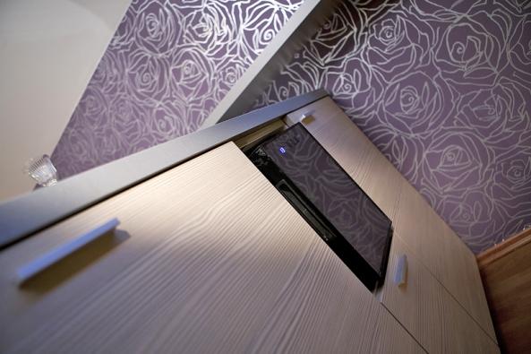 Tapeta pomáhá dotvářet azútulnit interiér.