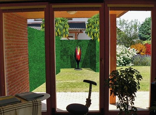Řešením je vysoká aúzká zelená stěna doplněná pro zpestření výraznou plastikou (point-de-vue).