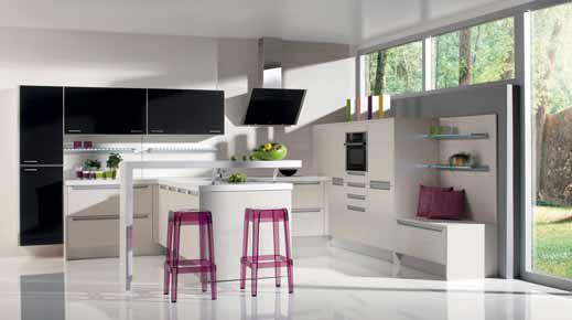 Atypické uspořádání s přidaným barovým pultem zajímavě využívá a vyplňuje velký prostor, a hospodyně se přitom příliš nenaběhá. Kuchyň je rozdělena na část pracovní (vpravo) a část stolovací (vlevo), kde se také ukládá bílé nádobí (linka Sibila, Gorenje).