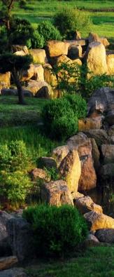 Původně to byla soukromá meditační zahrada, která vznikla podle návrhu japonského architekta Takumi Mizokamiho.
