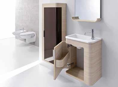 """""""Mini koupelna"""" Guest je složena z umyvadlového kontejneru, zrcadla, osvětlení, poličky a umyvadla. Unikátní oblé tvary skříňky nabízené ve variantě bříza – wengé nebo lakované v barvě range ve stejném provedení je nabízena také zrcadlová polička."""