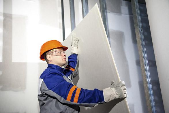 Sádrokarton je praktický stavební materiál, který vnitřní výstavbu výrazně zrychluje azlevňuje (KNAUF).