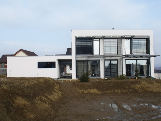 3: Tyto domy nesou pečeť svrchovaného architektonického úsilí o kvalitní výsledek. Jsem přesvědčen, že jejich investoři nákladů na dobrý projekt nelitují, říká architekt Jan Rampich.