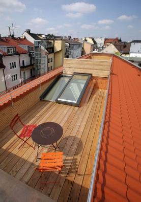 Posuvný střešní výstup Solara PERSPEKTIV v centru Mnichova.