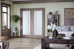 Dvoukřídlé dveře SONG sodolným laminátovým povrchem CPL vdekoru ořech avýplní zmatného skla mají oblé hrany (SOLODOOR)