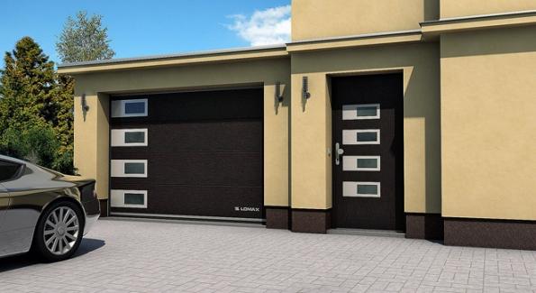 Výklopná vrata (zajíždějí kestropu) Lomax Delta, korespondující barvou idesignovým řešením svchodovými dveřmi domu.