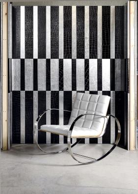 Stěna potažená kůži ahoupací křeslo provedené vnetradiční kombinaci kůže anerezu jsou odspolečnosti Soffitti Pelli.