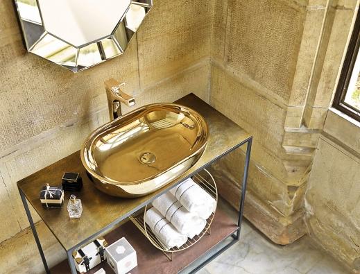 Kolekce Gold + Silver (vyrábí Bathco) obsahuje oválná akruhová keramická umyvadla sosmi dekory se zlatým nebo stříbrným povrchem. Umyvadlo Toulouse Gold má nadčasové použití.