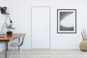Přítomnost dveří se skrytou zárubní  apovrchovou úpravou odpovídající sousední zdi prozradí jen klika (model Harmony, nabízí síť prodejen Siko, www.siko.cz)