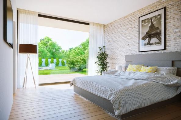 Bungalov Lukáš 23 se vyznačuje výrazným moderním designem s dominantní prosklenou fasádou. Ideálně se hodí na rovinatý pozemek s jižní orientací. (Ekonomické stavby)