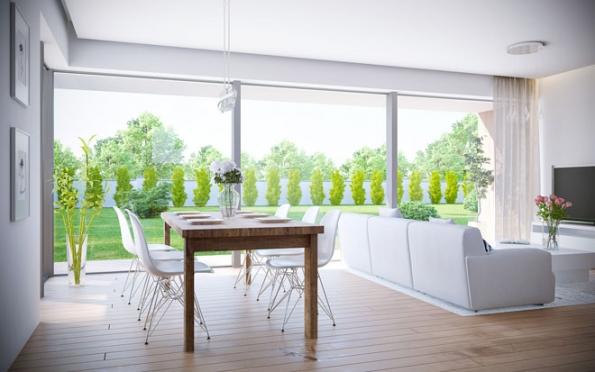 Společný obývací prostor domu Lucie nabízí luxus nerušeného panoramatického výhledu a velké množství světla Kuchyň je umístěna tak, aby v interiéru nerušil přímý pohled na linku, ale aby zároveň zůstala otevřenou součástí společného prostoru V celém domě včetně koupelen vládne střízlivý moderní design, který promyšleně koresponduje s osvětlením (Foto: Ekonomické stavby)