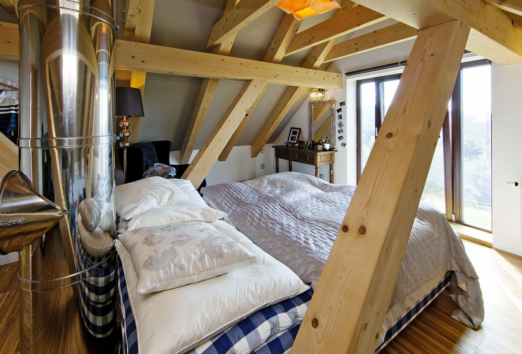 Také pokoje vpodkroví byly navrženy tak, aby měly co nejvíce volného prostoru ahezké výhledy.