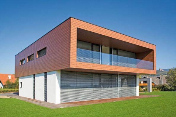 Rodinný dům v Rakousku s fasádním systémem StoTherm Wood, omítkou Stolit K6 a fasádní barvou StoColor Lotusan.