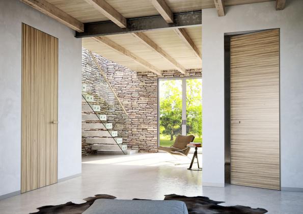 Dveře zřady MASTER DOOR mohou nést nasvém povrchu díky moderní hliníkové konstrukci různé materiály, ato včetně dýhy. Vkombinaci se skrytou zárubní AKTIVE tvoří výrazný adokonalý designový prvek interiéru (J.A.P.)