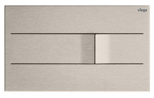 """Design ovládací desky Visign for More 201, která je vyrobena z jednoho kusu ušlechtilé oceli, zapůsobí především jedinečným zpracováním. Tlačítka obou funkcí splachování se v místě dotyku zvedají do tvaru měkké vlnky a narušují tak jinak čistě puristický vzhled desky. Achim Pohl, diplomovaný designér a CEO společnosti ARTEFAKT design z Darmstadtu, popisuje Visign for More 201 jako """"ovládací desku s maximálně puristickým vzhledem. Zhotovení z jediného kusu ušlechtilé oceli jí propůjčuje decentní výjimečnost, která potěší každé oko."""" Podsvícení formou LED rámu, který lze k desce doobjednat, dokáže ještě více zdůraznit její jedinečnost. Visign for More 201 je  k dostání v kartáčovaném nerezu, v pozlacené variantě nebo v barvách alpská bílá a antracit. Možná je i vestavba v jedné rovině s obkladem. (Foto: Viega)"""