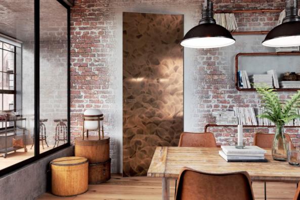 Efektní řešení (nejen) do industriálních interiérů představují dveře MASTER DOOR s CPL laminátem na povrchu, zde v dekoru mosazi. Usazeny jsou do skryté zárubně (JAP FUTURE)