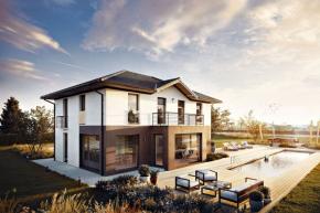 Architektura domu spojuje klasické principy a stavební prvky – symetrii a vyvážené proporce – s moderním designem, například velkoplošným zasklením, které navíc vytváří na terase příjemnou zimní zahradu